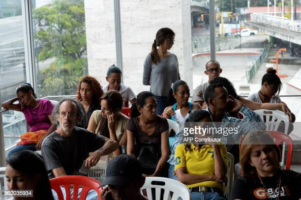 Supporters of the opposition's candidate for governor for the state of Miranda Mayor of Caracas' Sucre Municipality Carlos Ocariz show their...