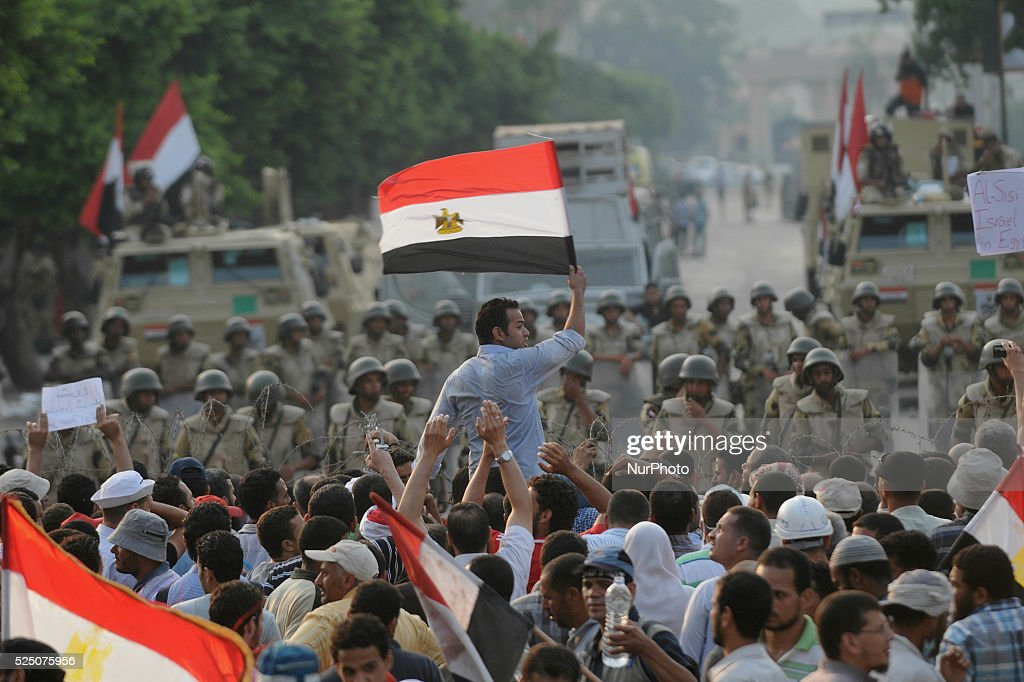 Supporters of the ousted President Mohammed Morsi gather in front of army check point in Cairo Egypt Monday July 8 2013 Photo Nameer Galal/NurPhoto