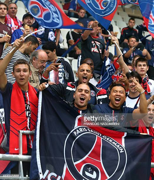 Supporters of the Paris SaintGermain football team wave flags as they cheer their team prior to the start of the French L1 football match between...