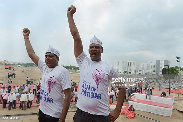 Supporters of the Patidar Anamat Andolan Samiti pose wearing 'Son of Patidar' tshirts at the GMDC Ground in Ahmedabad on August 24 2015 Patel Patidar...