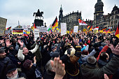 Supporters of the Pegida movement applaud during their weekly demonstration on January 25 2015 in Dresden Pegida is an acronym for 'Patriotische...