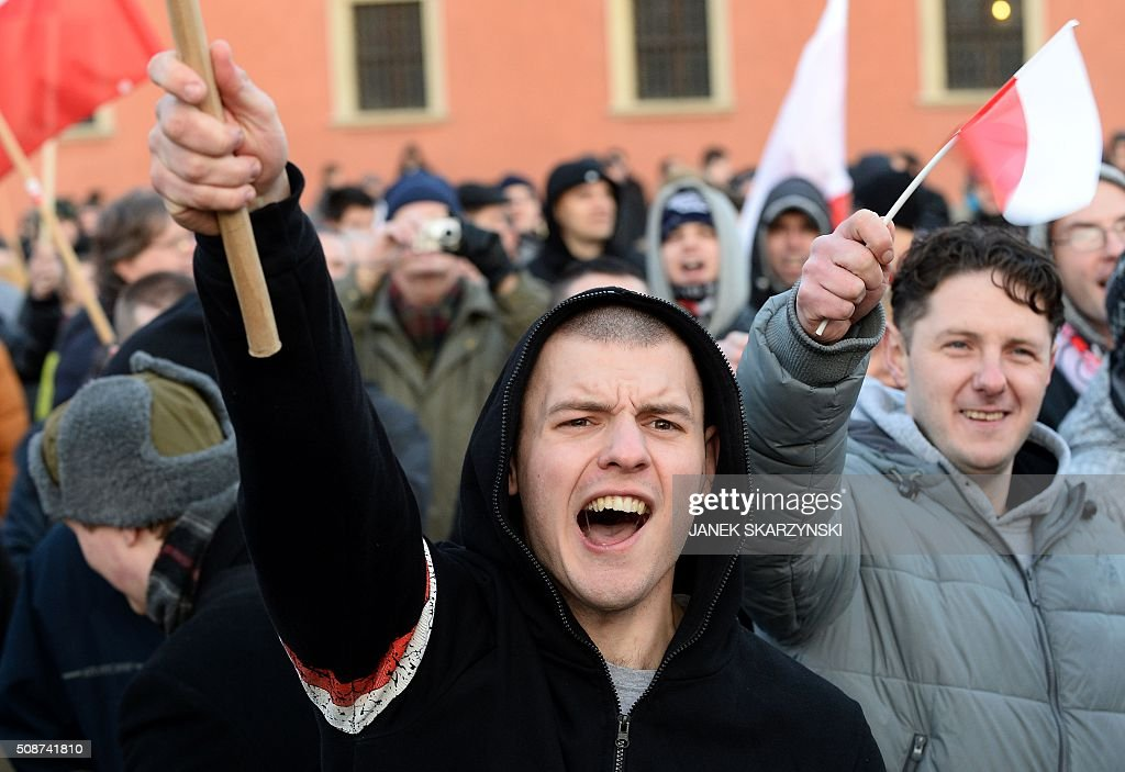 Supporters of the Pegida movement (Patriotic Europeans Against the Islamisation of the Occident) demonstrate in Warsaw on February 6, 2016 in Warsaw. / AFP / JANEK SKARZYNSKI