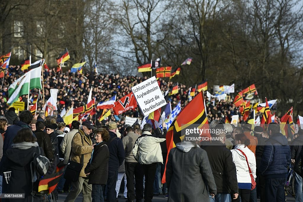 Supporters of the Pegida movement (Patriotic Europeans Against the Islamisation of the Occident) gather in Dresden, eastern Germany, on February 6, 2016. / AFP / TOBIAS SCHWARZ