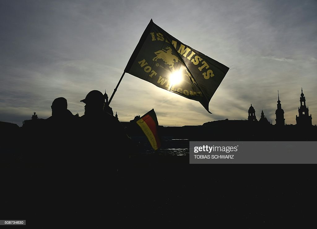 Supporters of the Pegida movement (Patriotic Europeans Against the Islamisation of the Occident) gather in Dresden, eastern Germany, on February 6, 2016. 'Islamists not welcome' / AFP / TOBIAS SCHWARZ