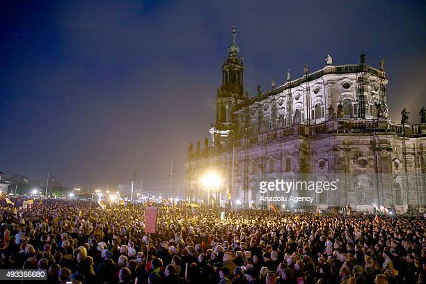 Supporters of the Pegida movement gather on the first anniversary of the antiIslam group march on October 19 2015 in Dresden Germany
