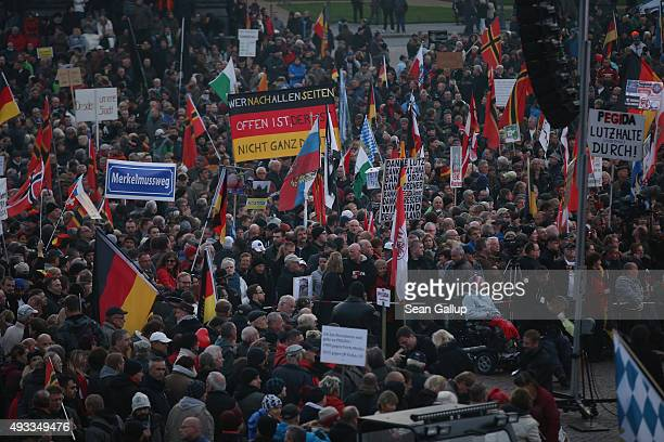 Supporters of the Pegida movement gather on the first anniversary since the first Pegida march on October 19 2015 in Dresden Germany Pegida is an...