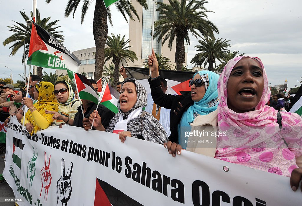 Supporters of the Polisario Front separatist movement hold a banner reading 'All for Palestine, all for Western Sahara' during a demonstration at the closing of the World Social Forum (WSF) on March 30, 2013 in Tunis.
