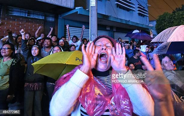 Supporters of the presidential candidate for the National Front Convergence Jimmy Morales celebrate in Guatemala City on October 25 2015 Comedian...
