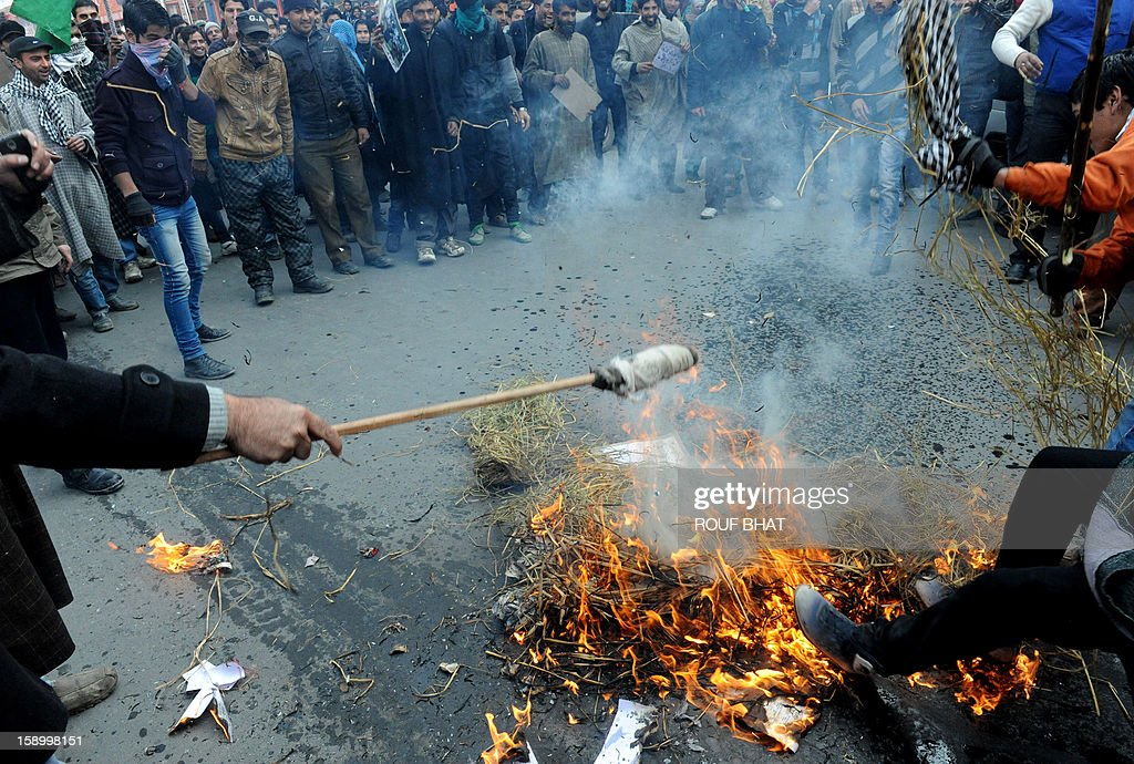 Supporters of the pro- India Peoples Democratic Party (PDP) burn an effigy of the local government during protest march in Srinagar on January 5,2013. The region's main opposition party took to streets to protest against corruption and price rises. AFP PHOTO/ Rouf BHAT