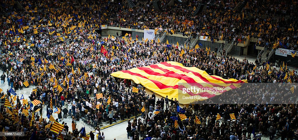 Supporters of the Pro-Independence Catalan party Convergence and Union (CIU) display a huge Catalan flag during the closing rally ahead of Catalan Elections at the Palau Sant Jordi on November 23, 2012 in Barcelona, Spain. Over five million Catalans will be voting in Parliamentary elections on November 25, with opinion polls showing majority support for pro-independence parties.