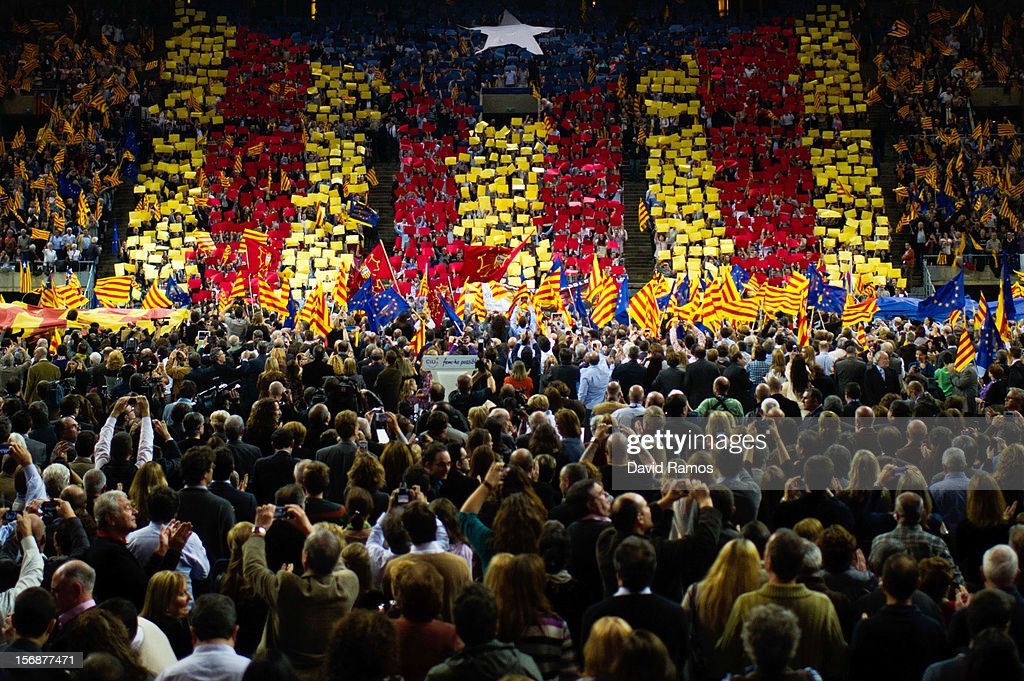 Supporters of the Pro-independence Catalan party Convergence and Union (CIU) display a 'Estelada', the Pro-Independence Catalonia's flag, during the closing rally ahead of Catalan Elections at the Palau Sant Jordi on November 23, 2012 in Barcelona, Spain. Over five million Catalans will be voting in Parliamentary elections on November 25, with opinion polls showing majority support for pro-independence parties.