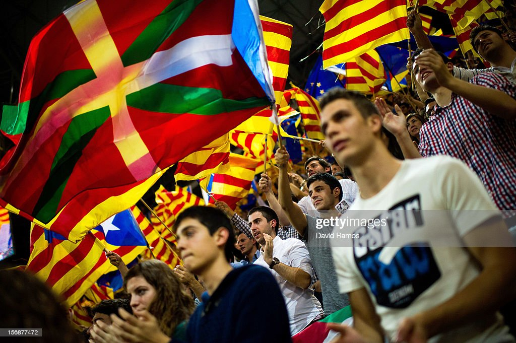 Supporters of the Pro-independence Catalan party Convergence and Union (CIU) fly a Basque Country flag among Catalan and European flags during the closing rally ahead of Catalan Elections at the Palau Sant Jordi on November 23, 2012 in Barcelona, Spain. Over five million Catalans will be voting in Parliamentary elections on November 25, with opinion polls showing majority support for pro-independence parties.