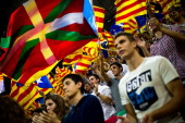Supporters of the Proindependence Catalan party Convergence and Union fly a Basque Country flag among Catalan and European flags during the closing...
