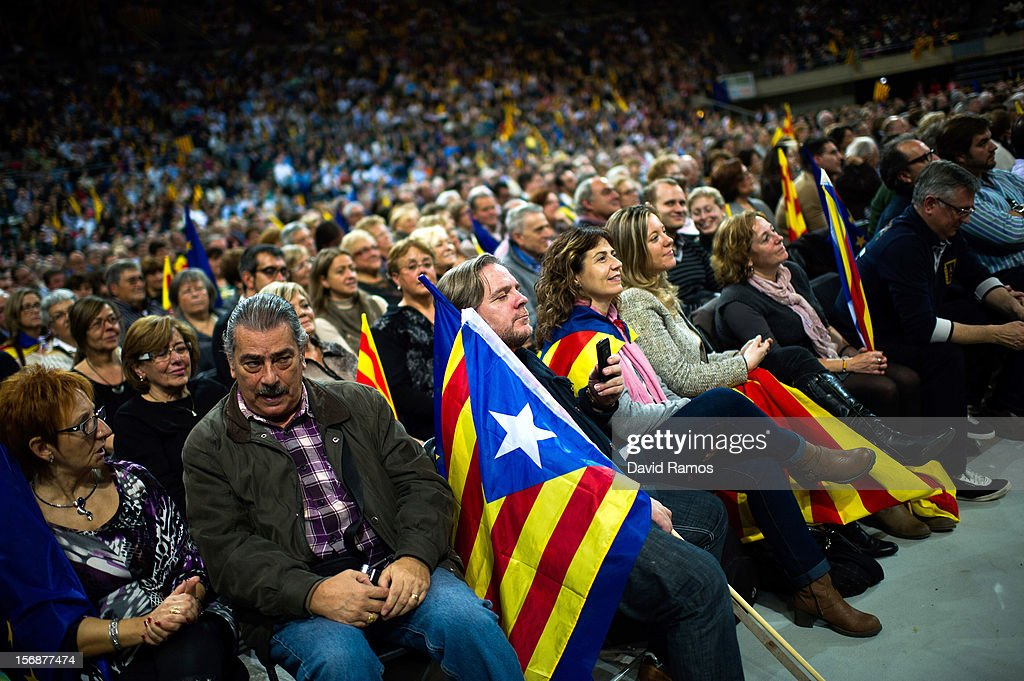 Supporters of the Pro-independence Catalan party Convergence and Union (CIU) listen as Artur Mas speaks during the closing rally ahead of Catalan Elections at the Palau Sant Jordi on November 23, 2012 in Barcelona, Spain. Over five million Catalans will be voting in Parliamentary elections on November 25, with opinion polls showing majority support for pro-independence parties.