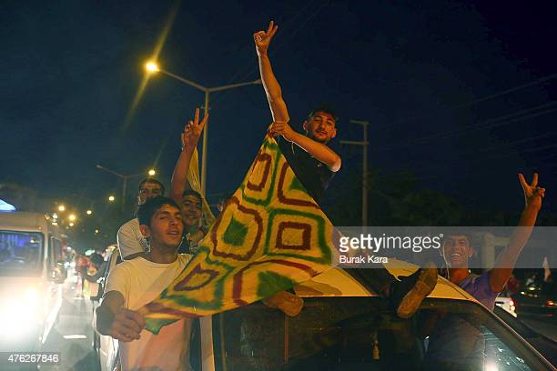 Supporters of the proKurdish Peoples' Democratic Party celebrate early election results June 7 2015 in Diyarbakir Turkey Partial results from...