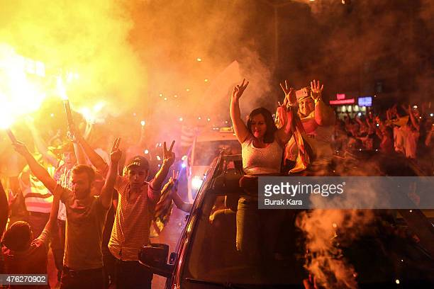 Supporters of the proKurdish Peoples' Democratic Party celebrate early election results in Diyarbakir Turkey June 7 2015 Partial results from...
