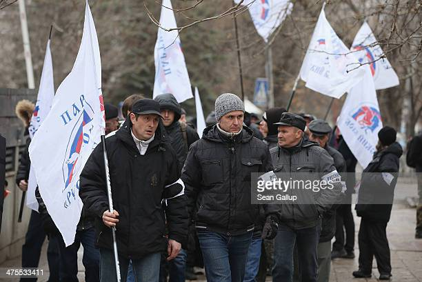 Supporters of the proRussian 'Russian Block Party' gather outside the Crimean parliament building on February 28 2014 in Simferopol Ukraine According...