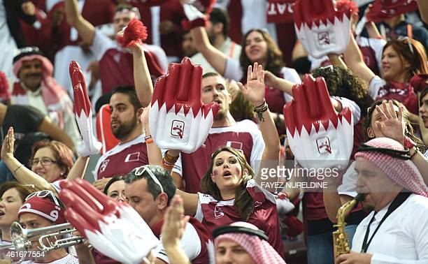 Supporters of the Qatari national team celebrate their team's victory during the 24th Men's Handball World Championships preliminary round Group A...
