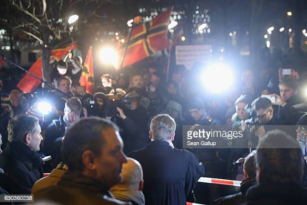 Supporters of the rightwing AfD political party hold a vigil near the Chancellery for victims of the recent Berlin Christmas market terror attack on...