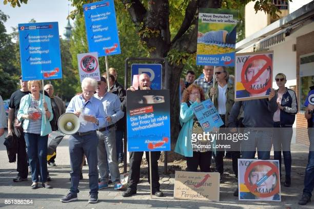 Supporters of the rightwing Alternative for Germany political party demonstrate against the German Chancellor and Christian Democrat Angela Merkel at...