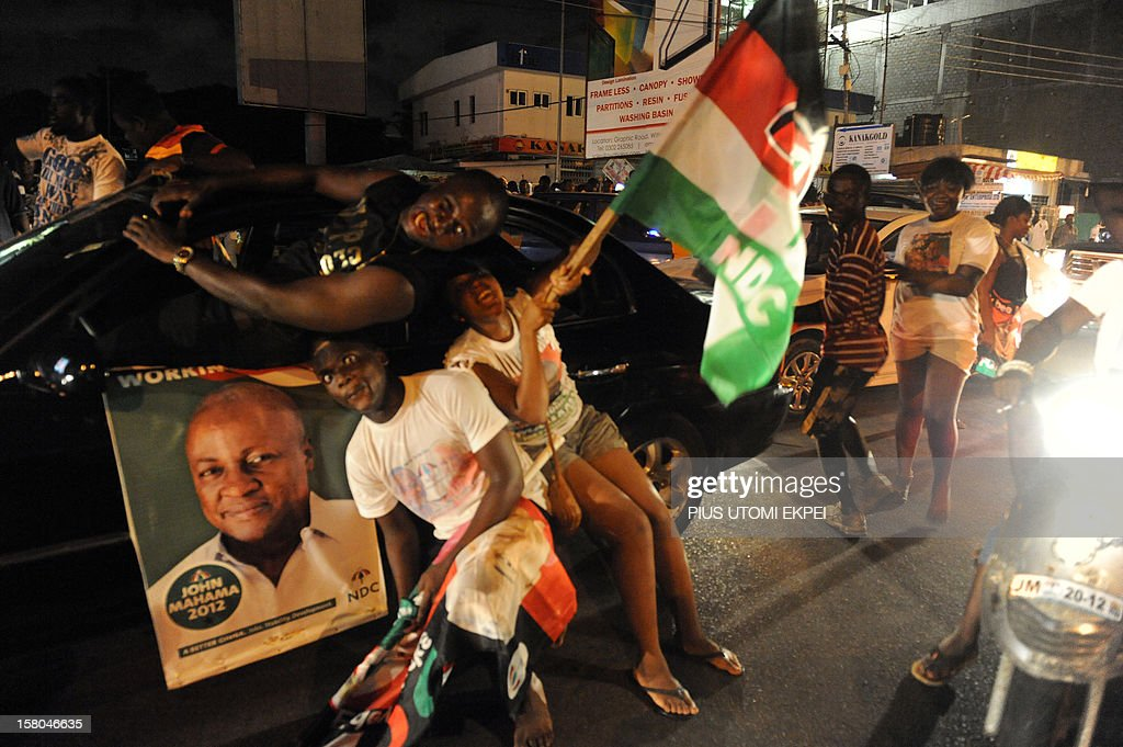 Supporters of the ruling National Democratic Party celebrate late on December 9 2012 in Accra the reelection of incumbent John Dramani Mahama after...