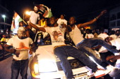Supporters of the ruling National Democratic Party celebrate on December 9 2012 in Accra the reelection of incumbent John Dramani Mahama after he was...