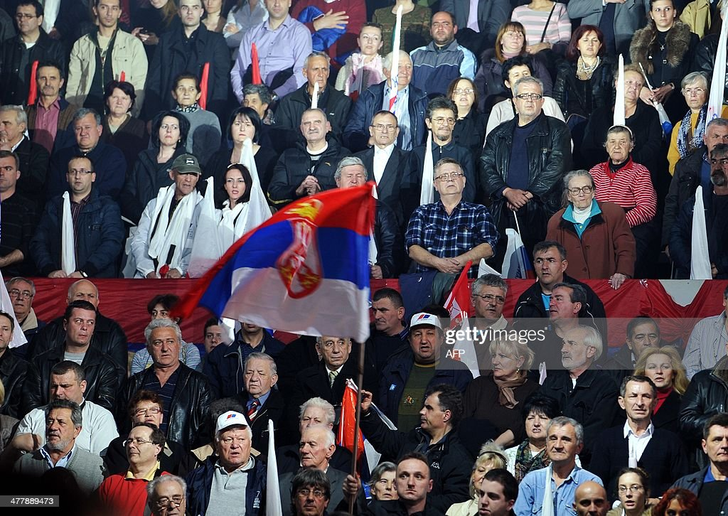 Supporters of the Serbian Progressive Party (SNS) sing the national anthem during an electoral rally in Belgrade on March 11, 2014. Serbian Deputy Prime Minister Aleksandar Vucic and leader of the SNS called early general elections in an effort to capitalise on its growing popularity after starting EU membership talks in January. Serbia goes to early polls on March 16, 2014.