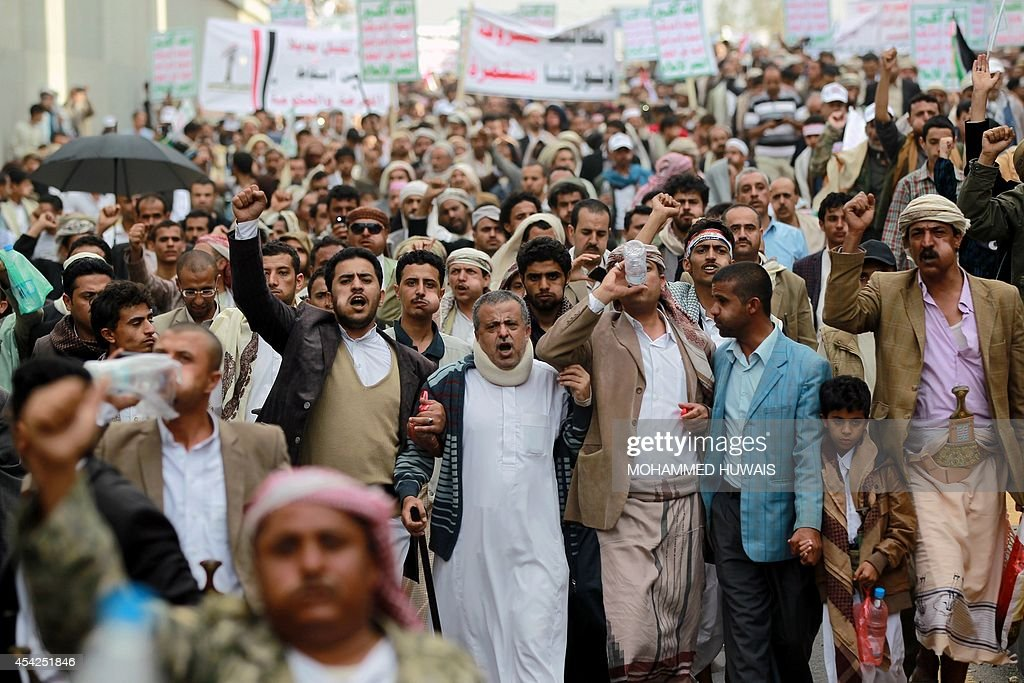 Supporters of the Shiite Huthi movement shout slogans during an anti-government protest on August 27, 2014 in the Yemeni capital Sanaa. Yemeni President Abdrabuh Mansur Hadi urged Shiite rebel leader Abdulmalik al-Huthi on August 26 to withdraw his militant followers from the capital following the failure of negotiations on their demands.