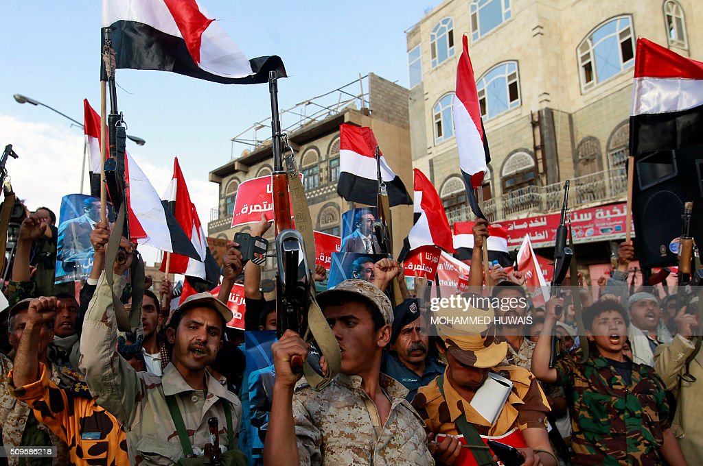 Supporters of the Shiite Huthi movement wave their national flag as they shout slogans during a rally commemorating the fifth anniversary of the 2011 Arab Spring uprising that toppled the then-president Ali Abdullah Saleh, on February 11, 2016 in the capital Sanaa. / AFP / MOHAMMED HUWAIS