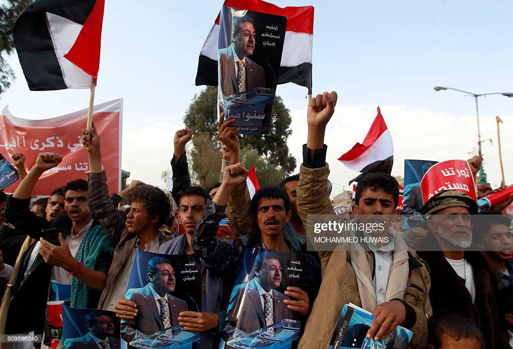 Supporters of the Shiite Huthi movement wave their national flag they shout slogans during a rally commemorating the fifth anniversary of the 2011 Arab Spring uprising that toppled the then-president Ali Abdullah Saleh, on February 11, 2016 in the capital Sanaa. / AFP / MOHAMMED HUWAIS