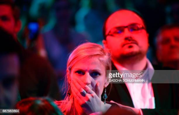 Supporters of the social democratic SPD party react as preliminary results of regional elections in the western German state of North RhineWestphalia...