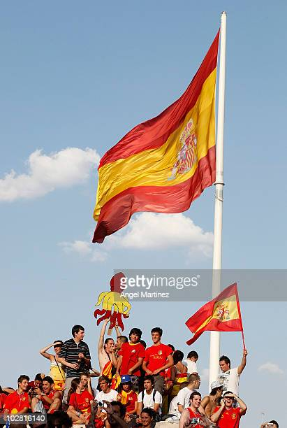 Supporters of the Spanish team attend a public viewing of the World Cup final football match between Spain and Netherlands at Plaza Colon on July 11...