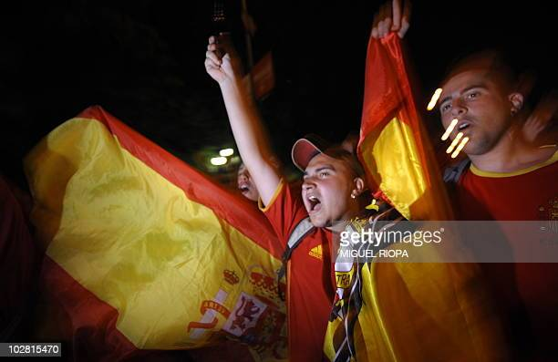 Supporters of the Spanish team celebrate after the World Cup final football match Spain against Netherlands on July 11 2010 in Madrid Spain won the...