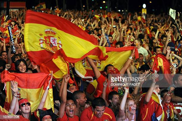 Supporters of the Spanish team celebrate during the World Cup semifinal football match Spain against Germany on July 07 2010 in Madrid A second half...