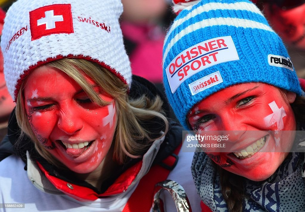 Supporters of the Swiss team cheer during a training of the Four-Hills-Tournament (Vierschanzentournee) in Garmisch-Partenkirchen, southern Germany on January 1, 2013. The second competition of the jumping event after Oberstdorf, takes place in Garmisch-Partenkirchen before the tournament continues in Innsbruck (Austria) and in Bischofshofen (Austria).