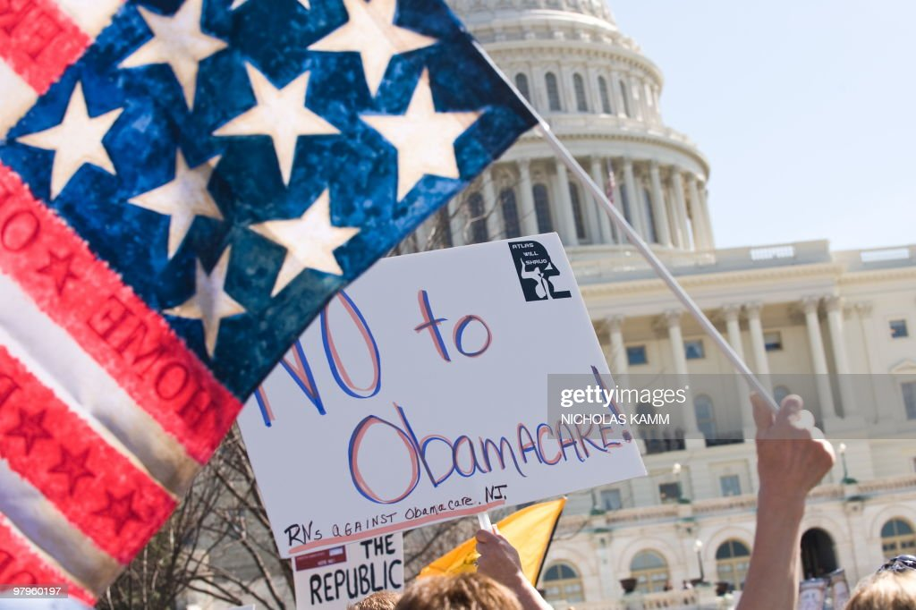 Supporters of the Tea Party movement demonstrate outside the US Capitol in Washington DC on March 20 2010 against the healthcare bill which is...