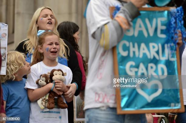 Supporters of the terminallyill British baby Charlie Gard react after the announcement that his parents have abandoned their legal fight to take...