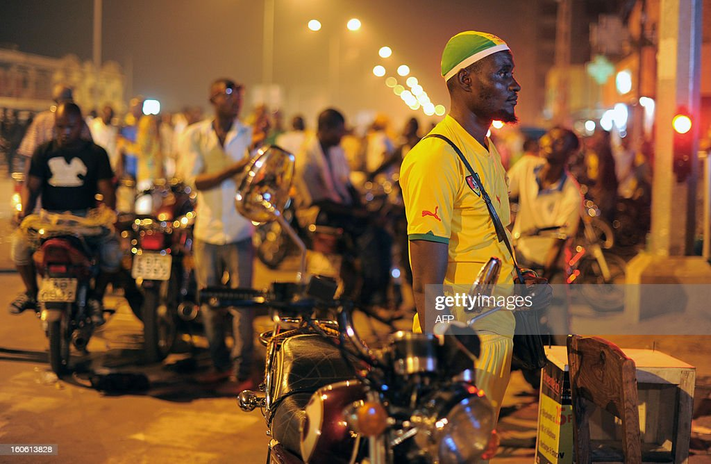 Supporters of the Togo football team react at the end of the African Cup of Nation 2013 quarter final football match between Burkina Faso and Togo, in Lome, on February 3, 2013. Burkina Faso qualified for the semi-finals of the 2013 Africa Cup of Nations Sunday by pipping Togo 1-0 after extra time. AFP PHOTO / Daniel Hayduk
