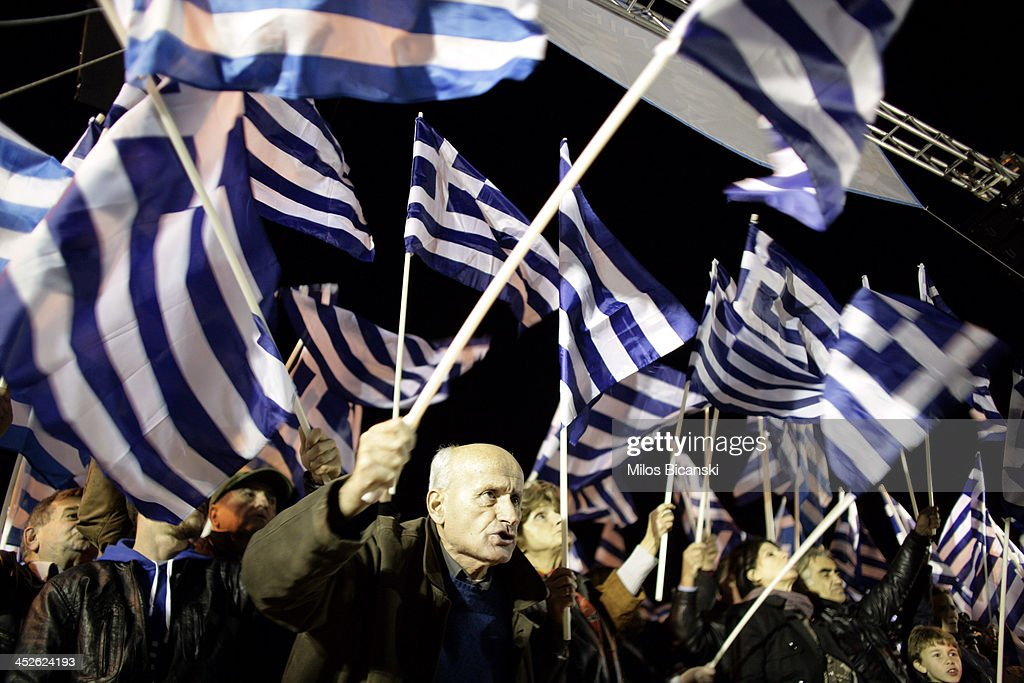 Supporters of the ultra-nationalist party Golden Dawn demonstrate outside parliament on November 30, 2013 in Athens, Greece. The Golden Dawn supporters are demanding the release of their party leader Nikolaos Mihaloliakos and members of parliament from detention.