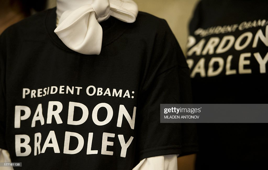 Supporters of the US Army Private First Class Bradley Manning wear shirts with signs 'President Obama: Pardon Bradley' during a press conference of his lawyer David Coombs at Arundel Reserve Hotel in Arundel , Maryland on August 21, 2013. Army Pfc. Bradley Manning was sentenced on Wednesday to 35 years in prison for giving hundreds of thousands of secret military and diplomatic documents to WikiLeaks in one of the nation's biggest leak cases since the Pentagon Papers more than a generation ago.