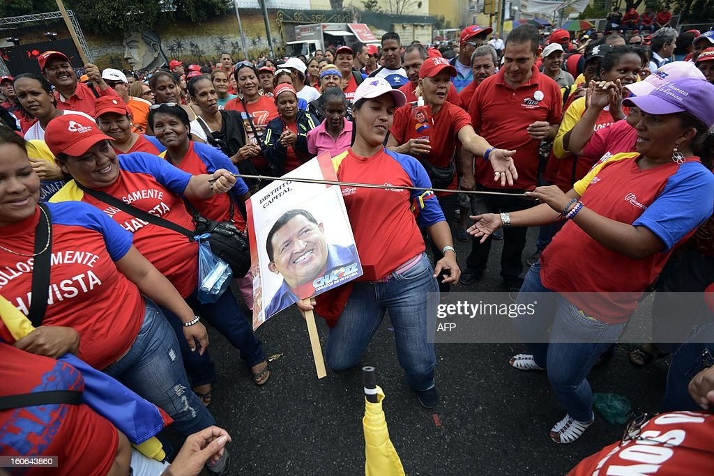 Supporters of the Venezuelan President Hugo Chavez take to the streets to conmemorate the 1992 failed coup led by Chavez, who was an army lieutenant colonel, against then president Carlos Andres Perez, in Caracas, on February 4, 2013. Ailing President Hugo Chavez, who had cancer surgery in December, is doing much better and recovering, Cuban leader Fidel Castro said in remarks published Monday. AFP PHOTO/Leo RAMIREZ