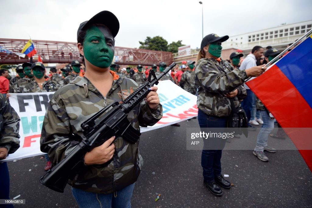 Supporters of the Venezuelan President Hugo Chavez with fake guns take to the streets to conmemorate the 1992 failed coup led by Chavez, who was an army lieutenant colonel, against then president Carlos Andres Perez, in Caracas, on February 4, 2013. Ailing President Hugo Chavez, who had cancer surgery in December, is doing much better and recovering, Cuban leader Fidel Castro said in remarks published Monday. AFP PHOTO/Leo RAMIREZ