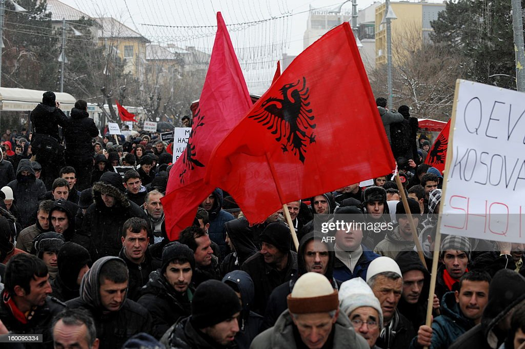 Supporters of the 'Vetevendosje' (Selfdetermination) movement march a protest in Pristina on January 26, 2013 to support the Albanians in the Valley of Presevo against the removal of the martyrs memorial by the Serb gendarmerie in Presevo. More than 3,000 ethnic Albanians protested on January 21, 2013 against Belgrade's removal of a memorial honouring their guerrillas and demanded 'demilitarisation' of this tense ethnically-mixed southern region of Serbia. AFP PHOTO/ARMEND NIMANI