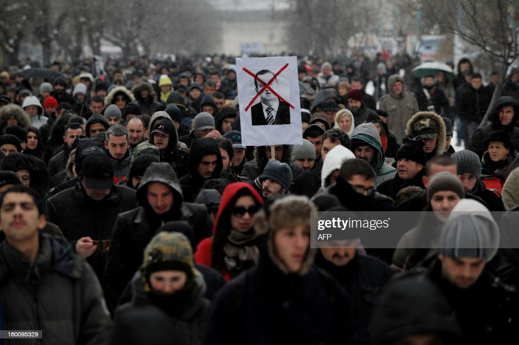 Supporters of the 'Vetevendosje' (Selfdetermination) movement shout slogans during a protest in Pristina on January 26, 2013 to support the Albanians in the Valley of Presevo against the removal of the martyrs memorial by the Serb gendarmerie in Presevo. More than 3,000 ethnic Albanians protested on January 21, 2013 against Belgrade's removal of a memorial honouring their guerrillas and demanded 'demilitarisation' of this tense ethnically-mixed southern region of Serbia.
