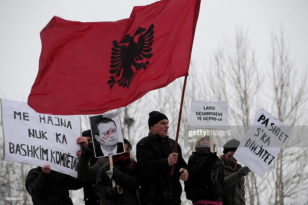 Supporters of the 'Vetevendosje' (Selfdetermination) shout slogans while carrying a portrait of Serbian Prime Minister Ivica Dacic at a protest in Pristina on January 26, 2013 to support the Albanians in the Valley of Presevo against the removal of the martyrs memorial by the Serb gendarmerie in Presevo. More than 3,000 ethnic Albanians protested on January 21, 2013 against Belgrade's removal of a memorial honouring their guerrillas and demanded 'demilitarisation' of this tense ethnically-mixed southern region of Serbia. AFP PHOTO/ARMEND NIMANI