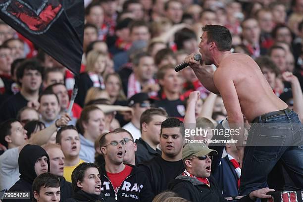 Supporters of the VfB Stuttgart are seen during the Bundesliga match between VfB Stuttgart and SC Karlsruhe at the Gottlieb Daimler stadium on...