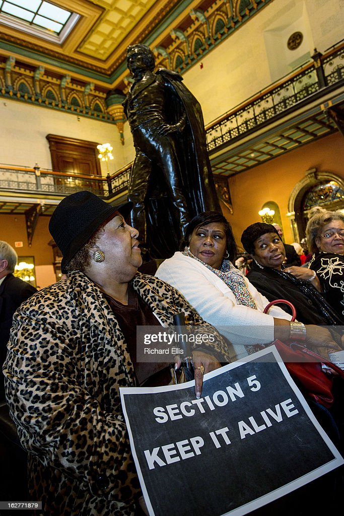 Supporters of the Voting Rights Act rally below a statue of the slavery defender John C. Calhoun in the South Carolina State House on February 26, 2013 in Columbia, South Carolina. The rally comes a day before the U.S. Supreme Court hears a case that could end a requirement for South Carolina and other states with histories of discriminatory voting practices to get federal approval for any new voting laws.