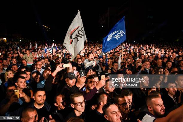 Supporters of the 'war wing' coalition celebrate their victory in Pristina on early June 12 2017 The coalition's candidate for prime minister Ramush...