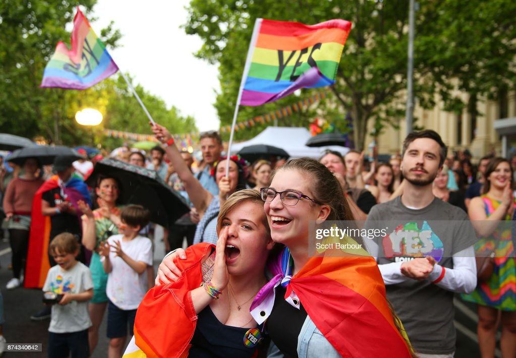 Supporters of the 'Yes' vote for marriage equality celebrate at Melbourne's Result Street Party on November 15, 2017 in Melbourne, Australia. Australians have voted for marriage laws to be changed to allow same-sex marriage, with the Yes vote claiming 61.6% to to 38.4% for No vote. Despite the Yes victory, the outcome of Australian Marriage Law Postal Survey is not binding, and the process to change current laws will move to the Australian Parliament in Canberra.