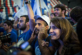Supporters of the Zionist Union party react to preliminary election results on March 17 2015 in Tel Aviv Israel The preliminary announcement of the...